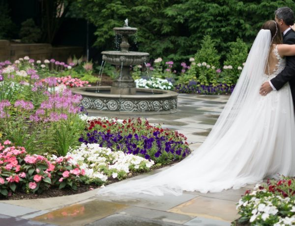 bride and groom outside embracing