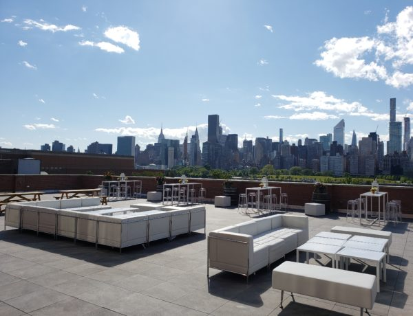 rooftop dining and lounge area with skyline view