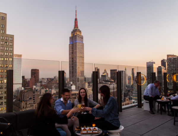 people sitting on a rooftop