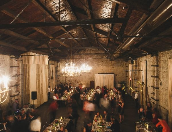 indoor event space with people eating at tables