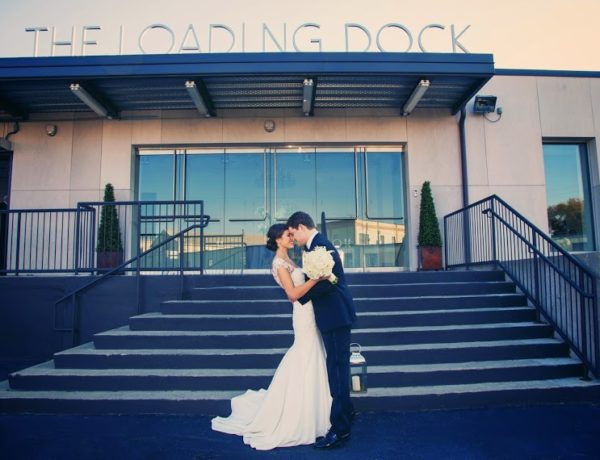 bride and groom embracing outside