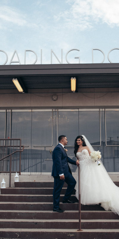 exterior image of venue with bride and groom