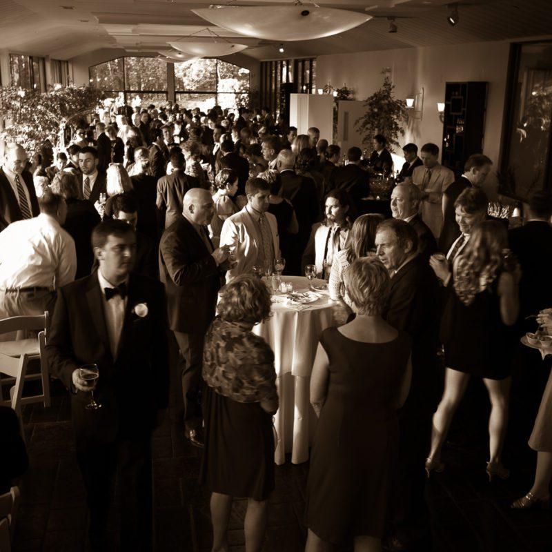 people talking at wedding reception