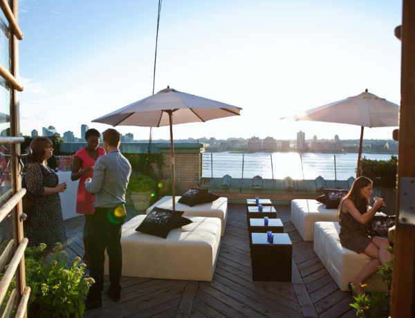 rooftop lounge area with waterfront view