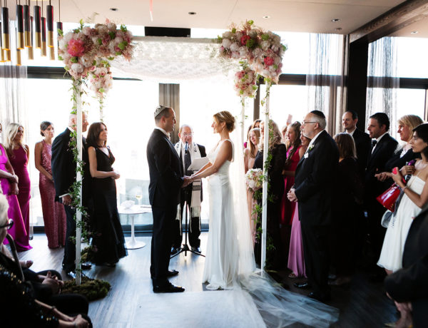 a wedding ceremony with a bride and groom at the skylark
