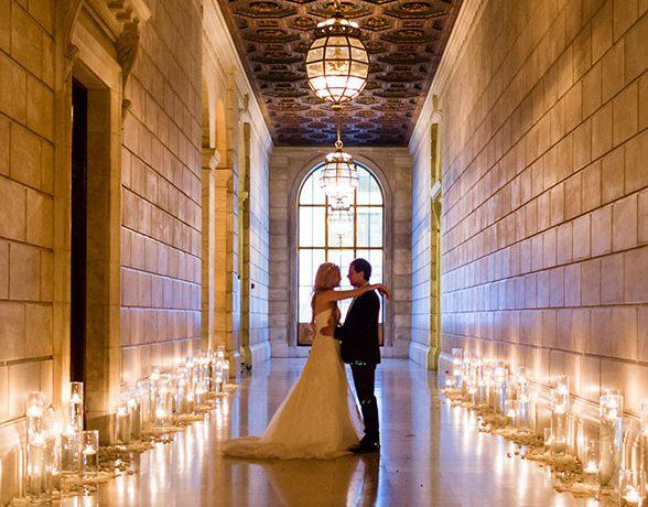 bride and groom embracing in hallway
