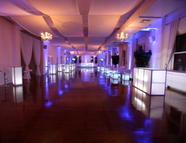 large interior venue with bars and tables