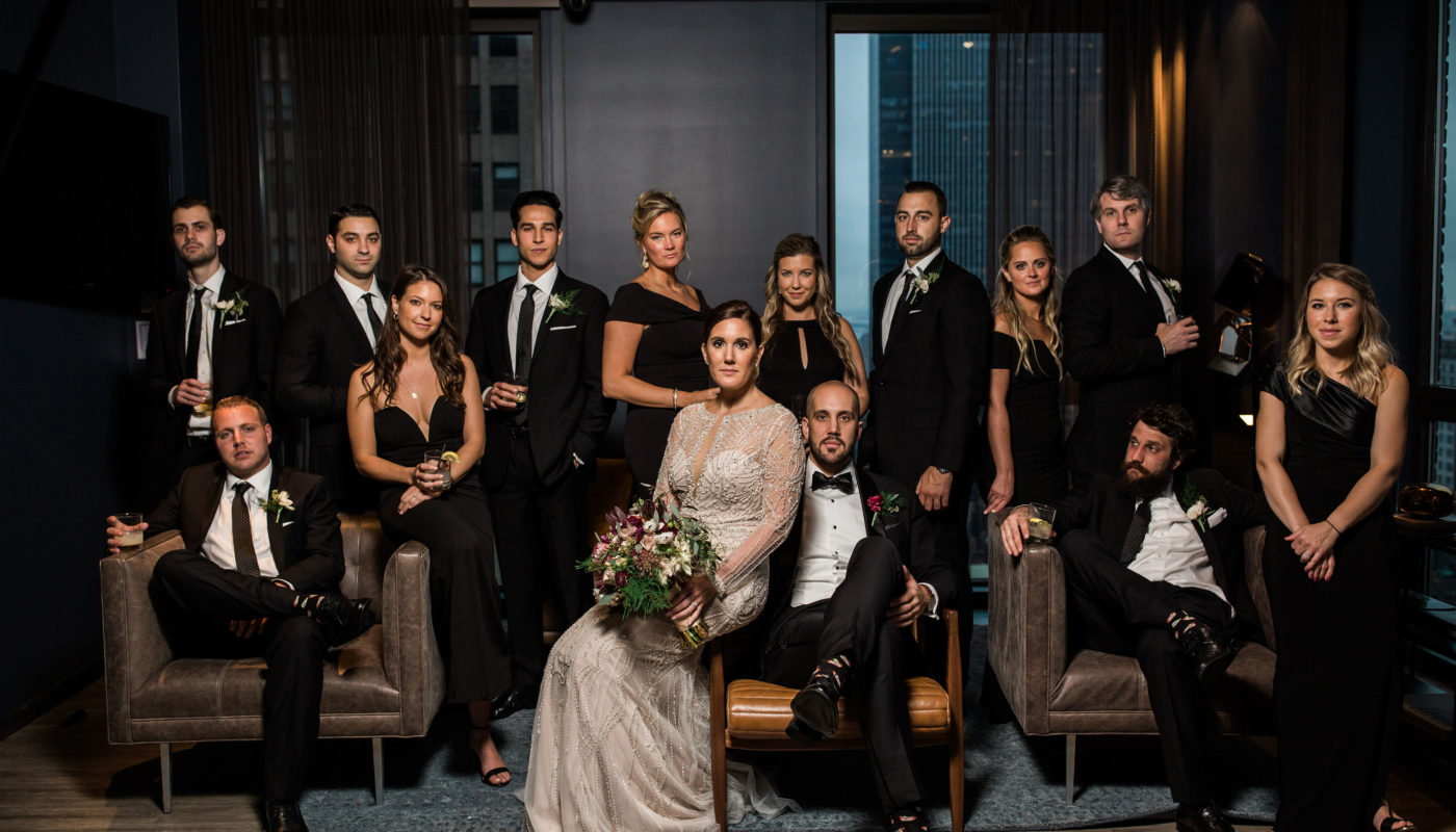 wedding party posing in a lounge