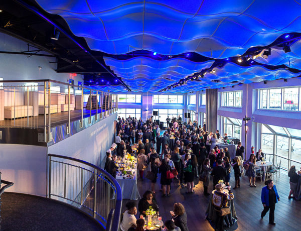 interior venue event space with beautiful blue lighting and lots of people
