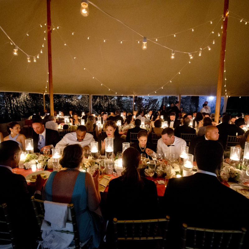 Fine dining area with table settings and people