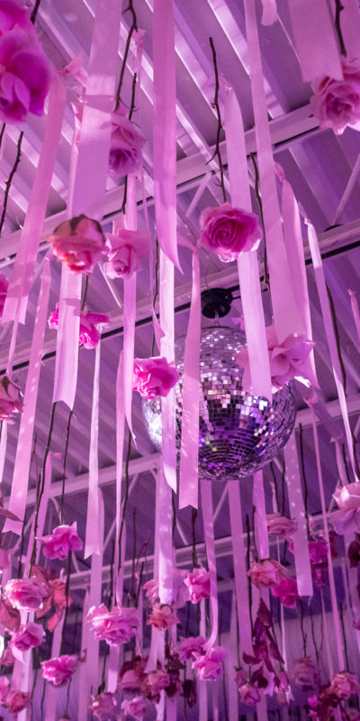floral decorations and a disco ball hanging from a ceiling