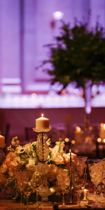 beautiful candle and floral centerpiece on a table
