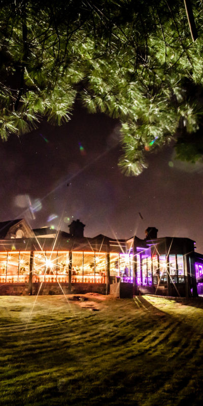 exterior lawn shot of a venue at nighttime
