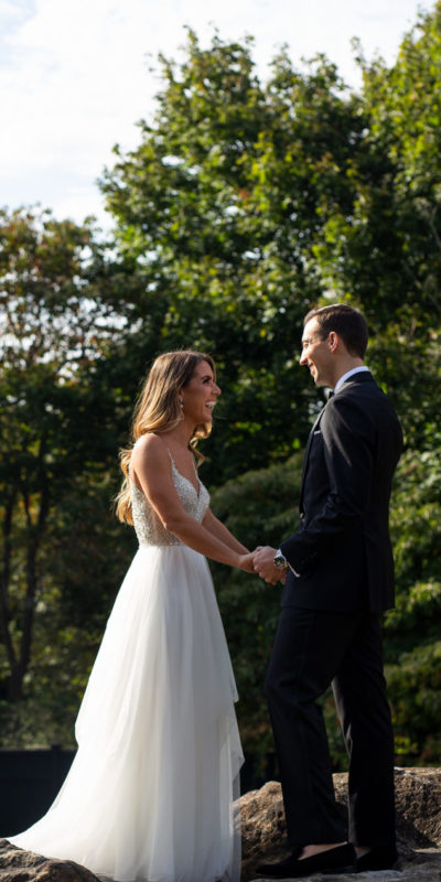 bride and groom holding hands outside