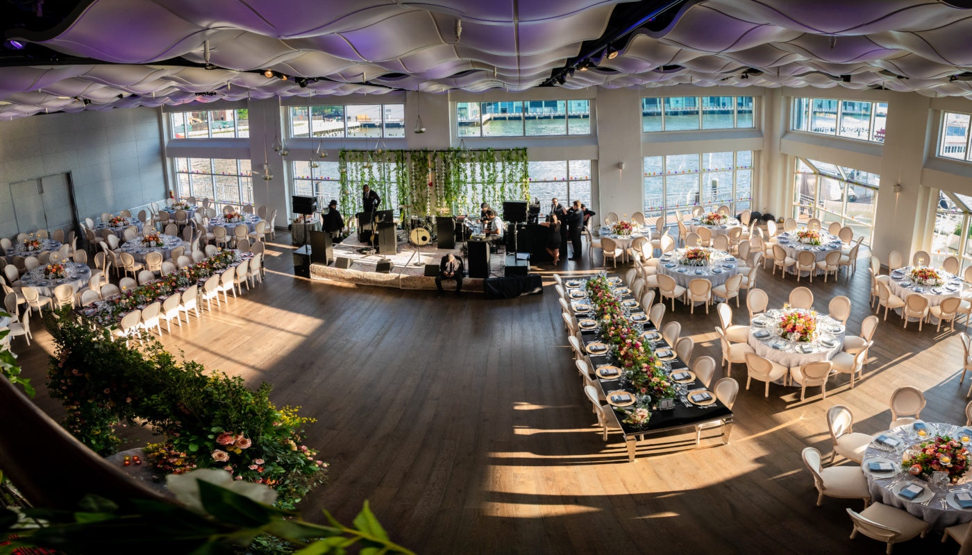 a band and a Fine dining area with table settings in a large room