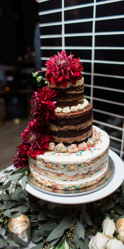 wedding cake with flowers on a table
