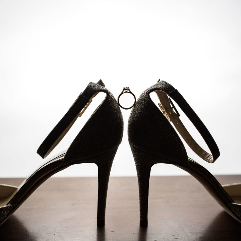 bridal shoes and wedding ring