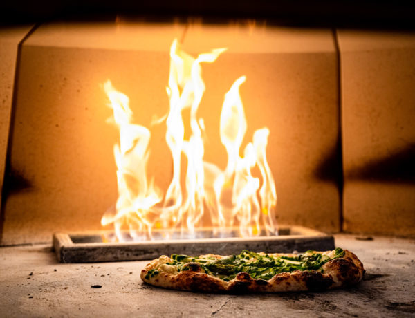 Flatbread cook in the open flame oven